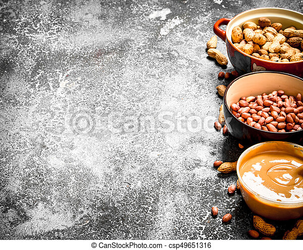 Nuts and peanut butter in a bowl. - csp49651316