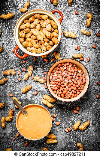 Nuts and peanut butter in a bowl. - csp49827211