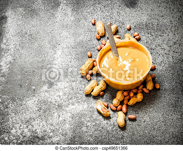 Nuts and peanut butter in a bowl. - csp49651366