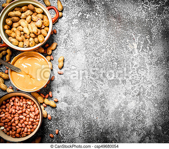 Nuts and peanut butter in a bowl. - csp49680054