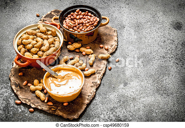 Nuts and peanut butter in a bowl. - csp49680159
