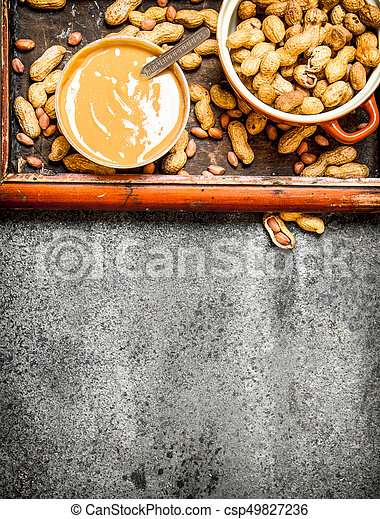 Nuts and peanut butter in a bowl. - csp49827236