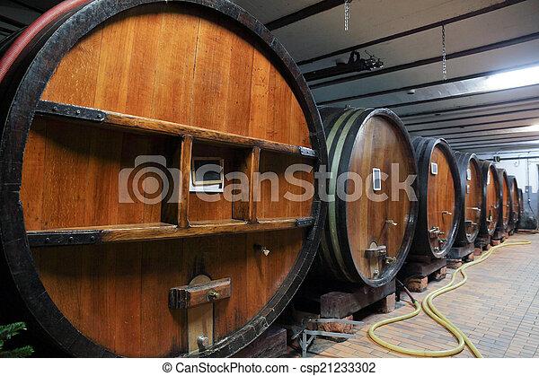 Oak wine barrels in a wine cellar - csp21233302