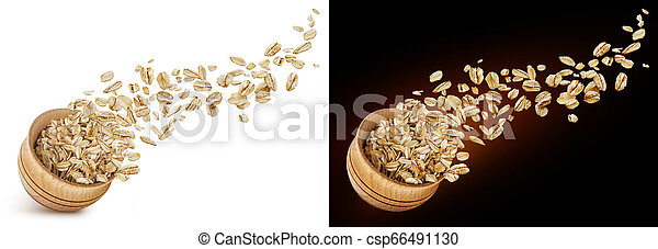 Oat flakes flying out of wooden bowl isolated on white and black background - csp66491130