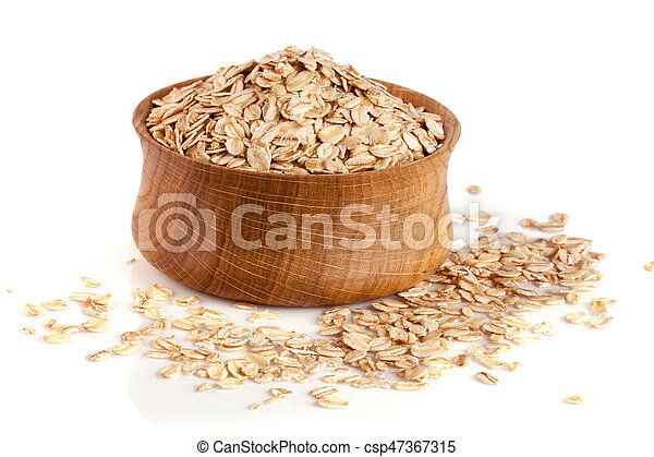 oat flakes in a wooden bowl isolated on white background - csp47367315