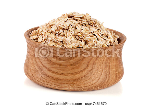 oat flakes in a wooden bowl isolated on white background - csp47451570