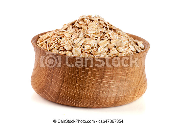 oat flakes in a wooden bowl isolated on white background - csp47367354