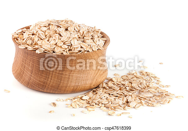 oat flakes in a wooden bowl isolated on white background - csp47618399