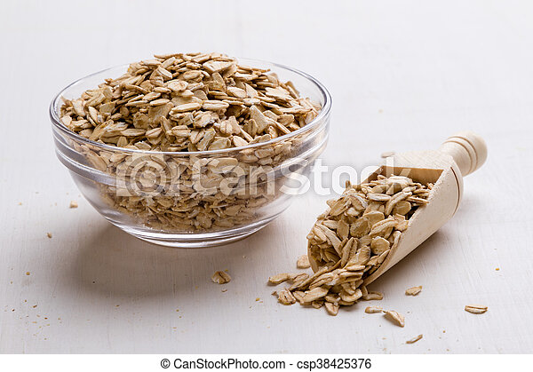 oat flakes in bowl and scoop - csp38425376