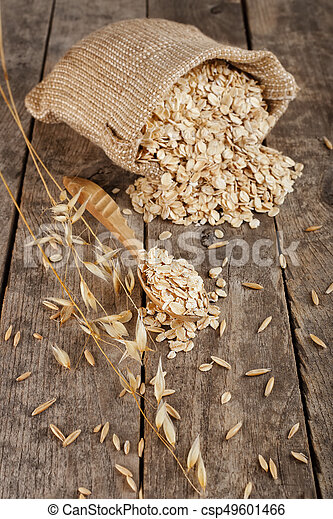 oat flakes in sack - csp49601466