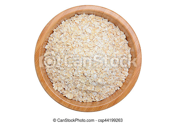 oat flakes in wooden bowl isolated on white - csp44199263