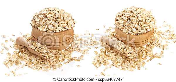 Oat flakes in wooden bowl isolated on white background - csp56407747