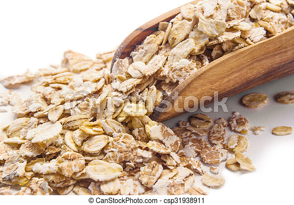 Oat flakes in wooden scoop isolated on white - csp31938911