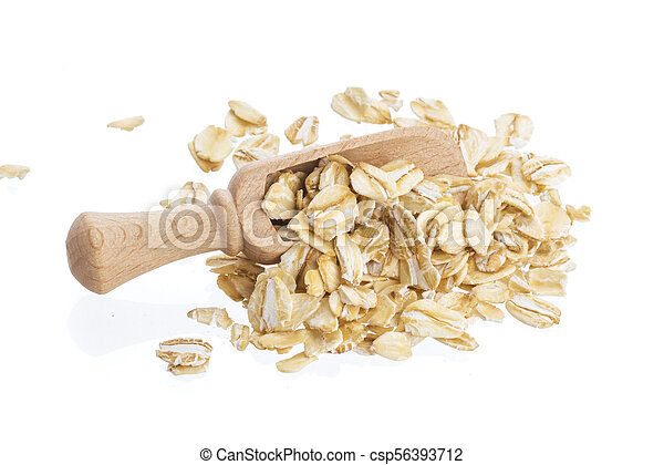 Oat flakes in wooden scoop isolated on white background. Close up. - csp56393712