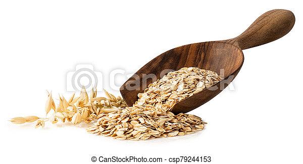 oat flakes in wooden scoop - csp79244153