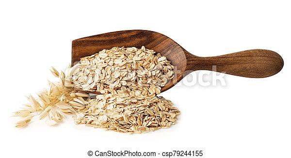 oat flakes in wooden scoop - csp79244155