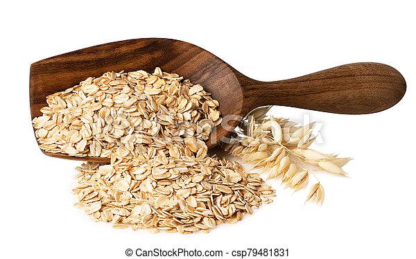 oat flakes in wooden scoop - csp79481831