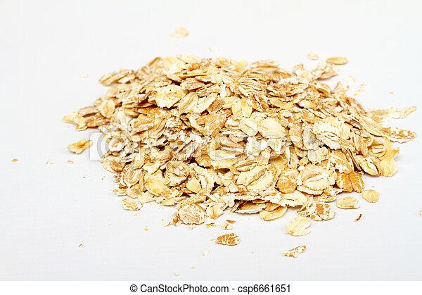Oat flakes on white background - csp6661651