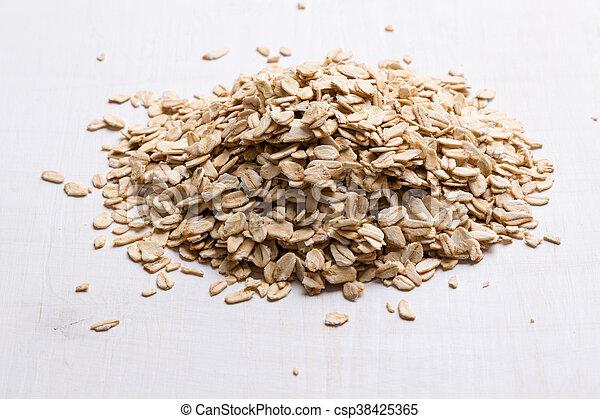 oat flakes on white table - csp38425365