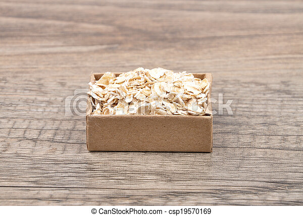 Oat flakes on wood - csp19570169
