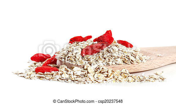 Oat flakes with goji berries on white background - csp20237548