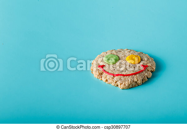 Oat smile cookies on aquamarine background - csp30897707