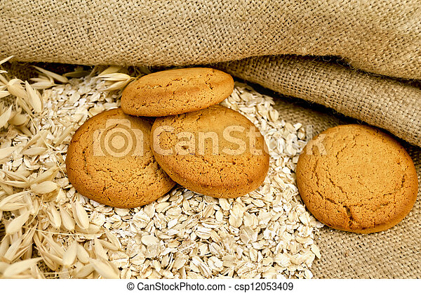 Oatmeal cookies with oatmeal on sacking - csp12053409