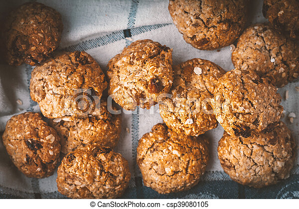 Oatmeal cookies with raisins on a towel - csp39080105