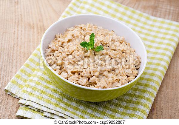 Oatmeal porridge healthy breakfast. - csp39232887
