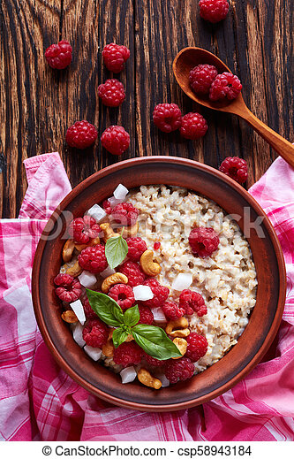 oatmeal porridge with raspberry and nut - csp58943184