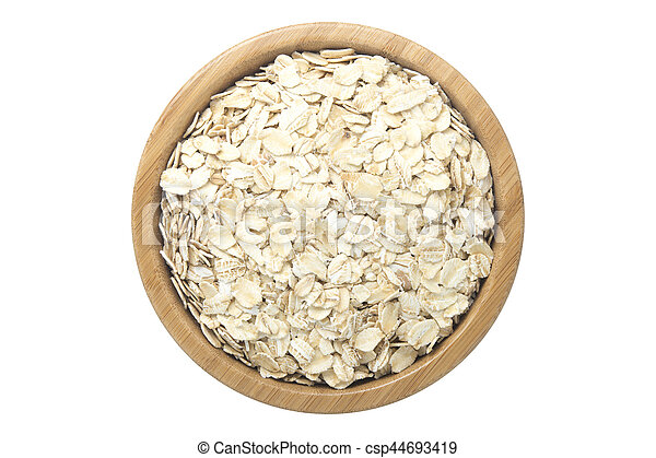 Oats in wooden bowl isolated top view on white - csp44693419