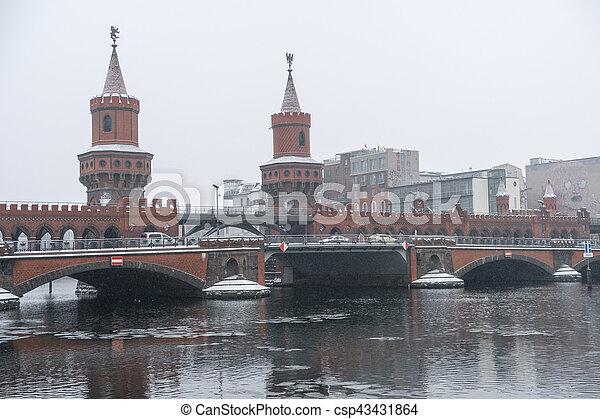 Oberbaum bridge (Oberbaumbrücke) in Berlin,  winter - csp43431864