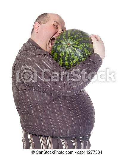 Obese man biting a watermelon - csp11277584