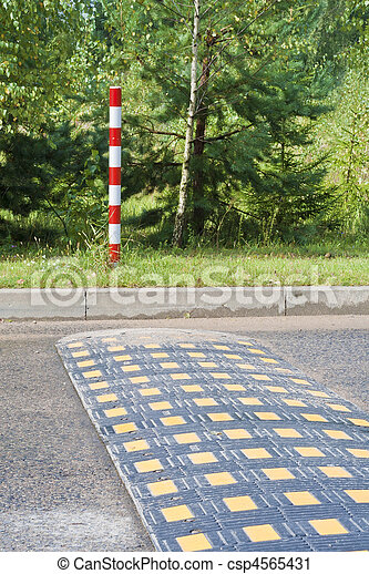 Obstacle inl road for restriction of speed  - csp4565431
