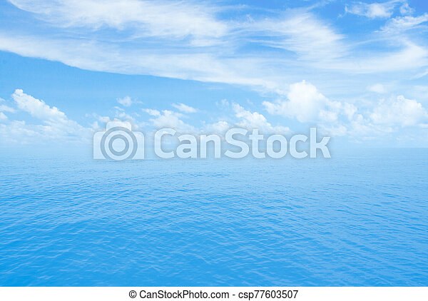 Ocean or sea calm water. Horizon line with partly cloud sky. - csp77603507