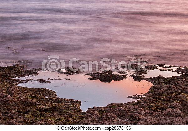ocean water bathing the coastline - csp28570136