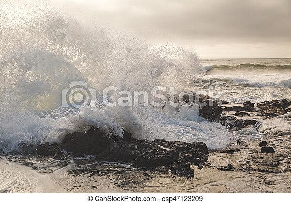 Ocean Waves Crashing into Rocky Shore - csp47123209