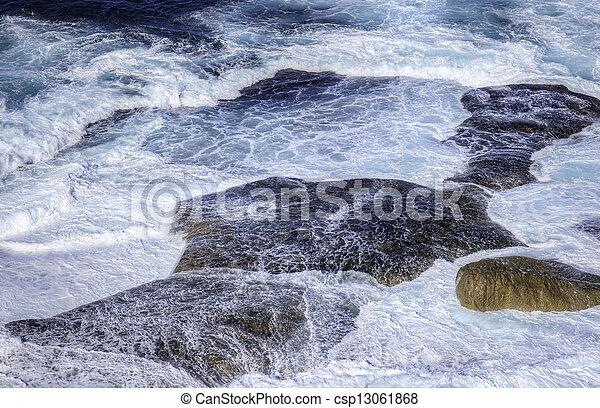 ocean waves crashing on rocks - csp13061868