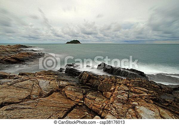 ocean waves crashing rocks - csp38176013