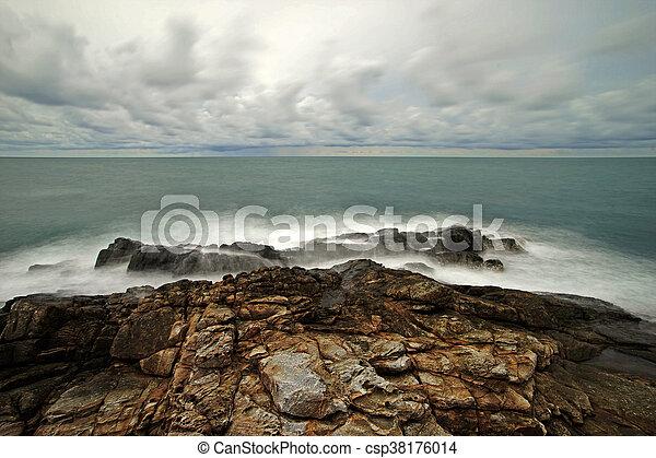 ocean waves crashing rocks - csp38176014
