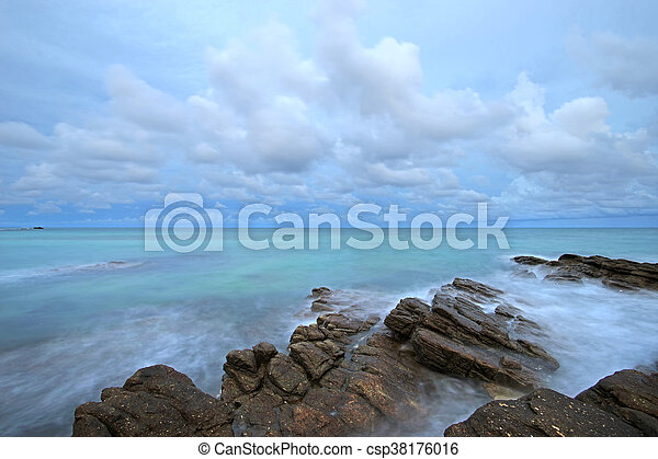 ocean waves crashing rocks - csp38176016