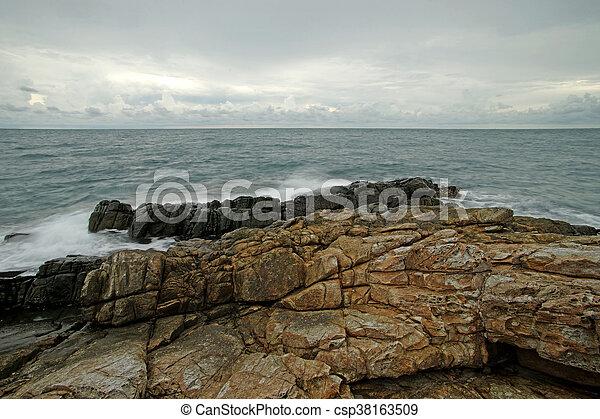 ocean waves crashing rocks - csp38163509