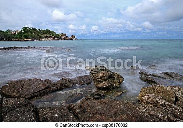 ocean waves crashing rocks - csp38176032