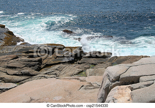 Ocean waves on rocks - csp21544330