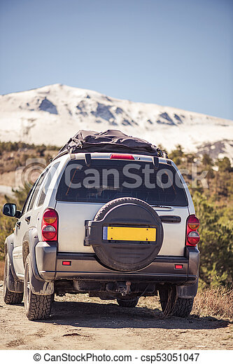 Off road car in snowy hill tops - csp53051047