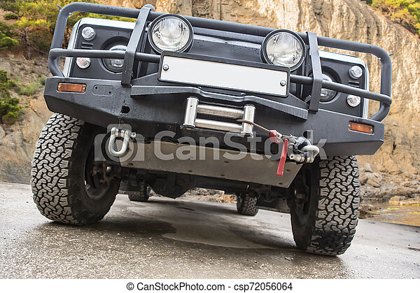 Off-road car on a mountain landscape - csp72056064