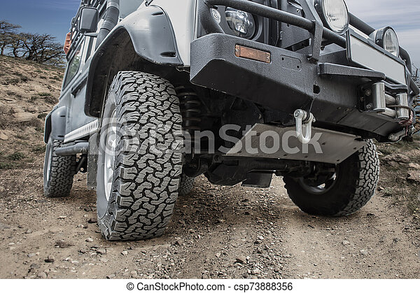 Off-road car on a mountain landscape - csp73888356