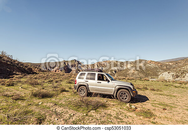 Off road car parked in mountains - csp53051033