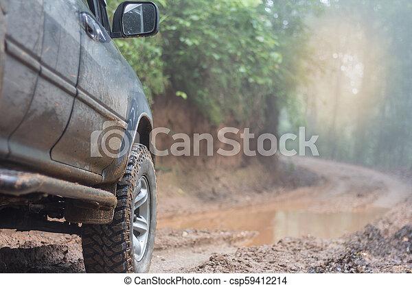 Off-road travel on mountain road, Adventure Travel, Rainy Season. - csp59412214