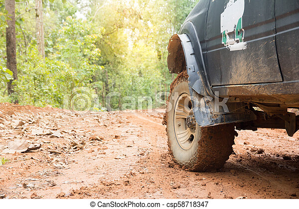 Off-road travel on mountain road. Outdoor, adventures, expedition, explore and travel suv. - csp58718347